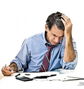 Man Worrying About Paying Bills and Bankruptcy